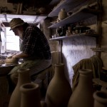 John Leach sits at the potter's wheel in his studio which is a 16th century converted building