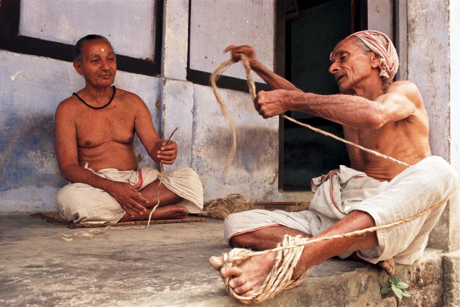 Monk making rope