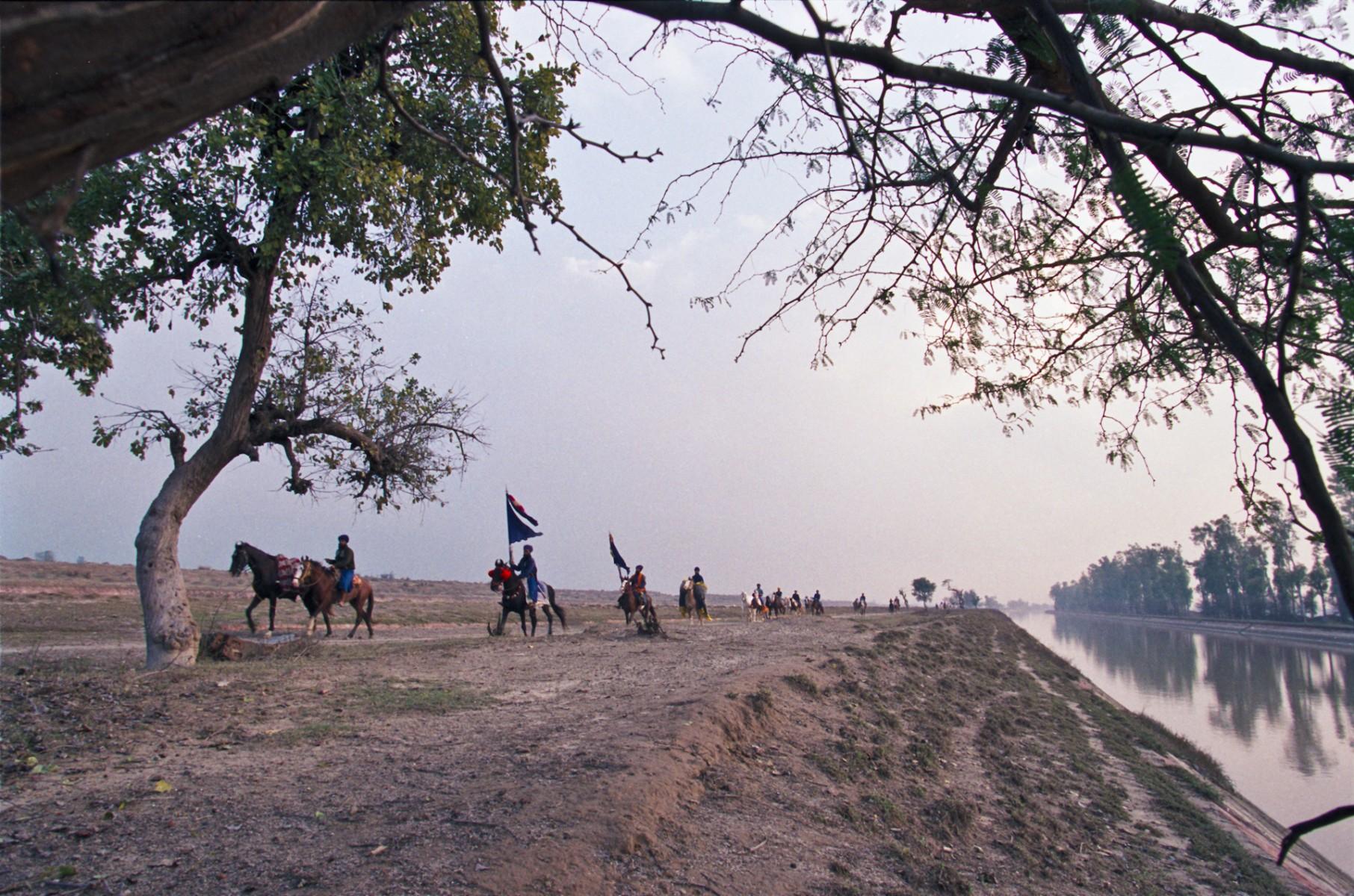 Nihangs by canal near Mudki