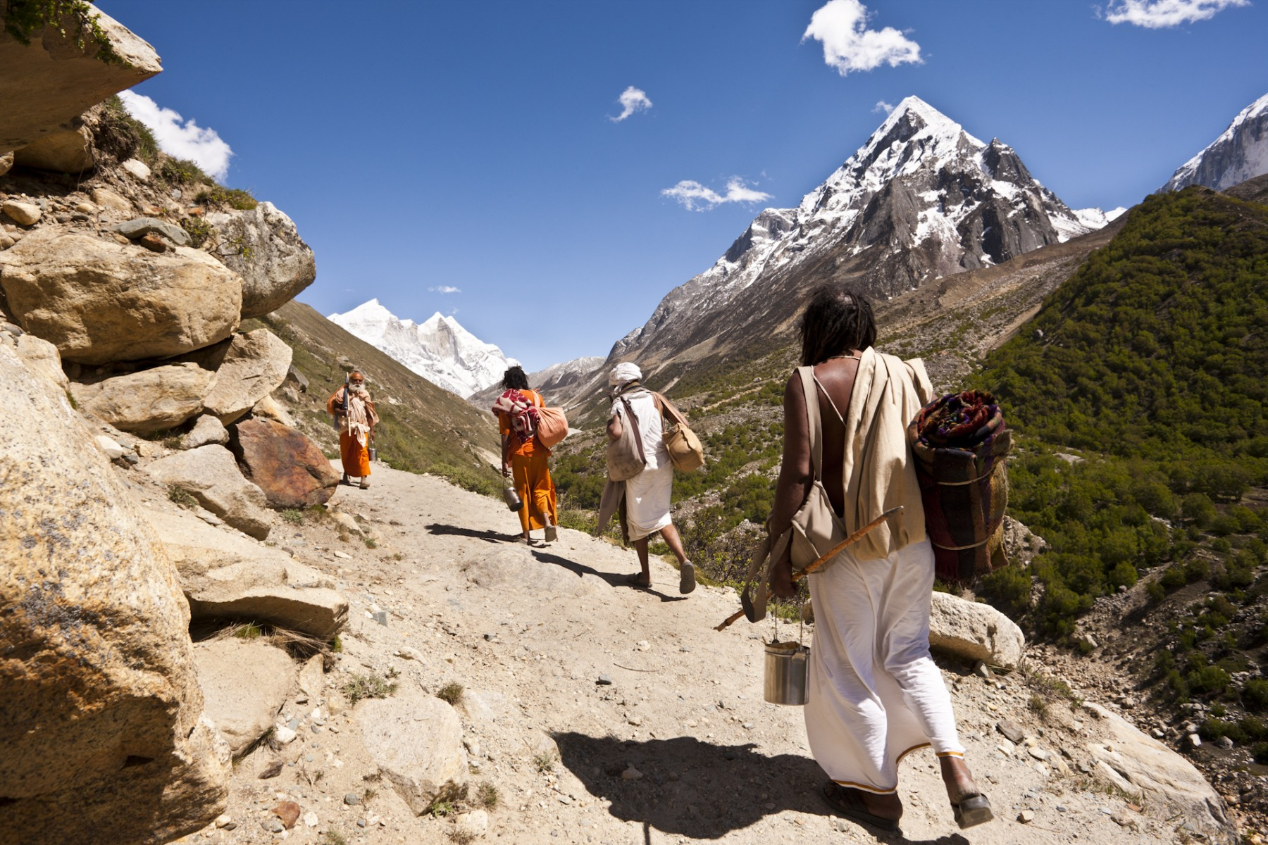 A group of Vaishnavite sadhus on the path to Gaumukh with the Bhagirathi peaks in the distance.
