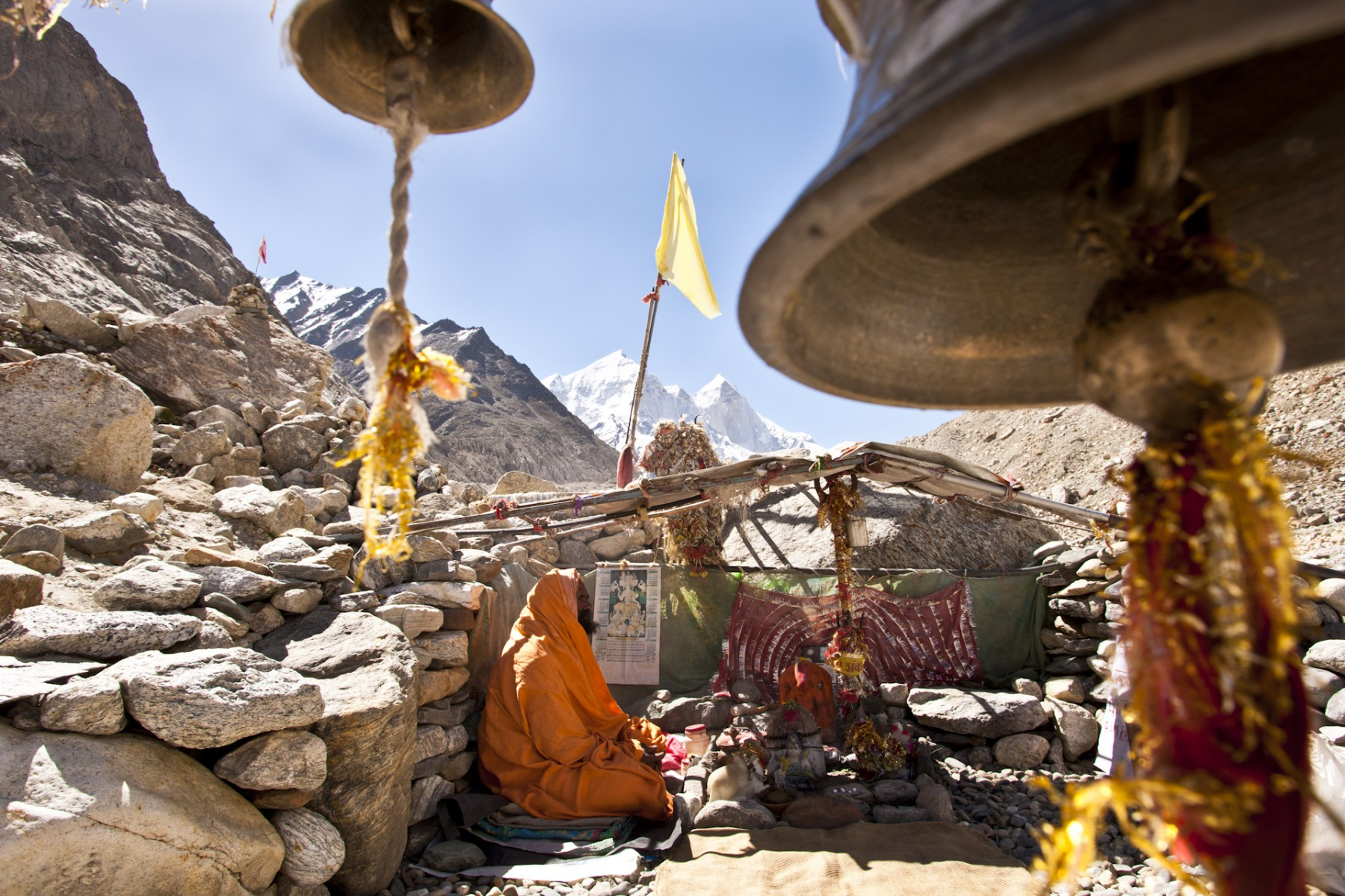Nirmal Das attends to the make-shift temple which is just a few hundred yards from Gaumukh every day during the summer months. His routine began in 1988.