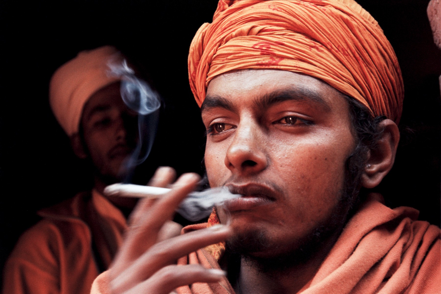 Young sadhu smoking
