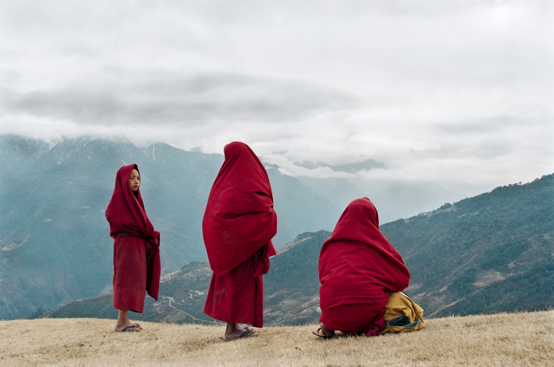 Monks overlooking valley