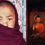 Young monk at entrance to Tawang Monastery