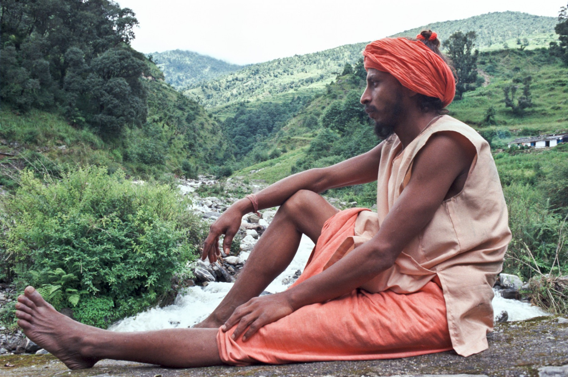 Sadhu sitting on bridge, Himalayas