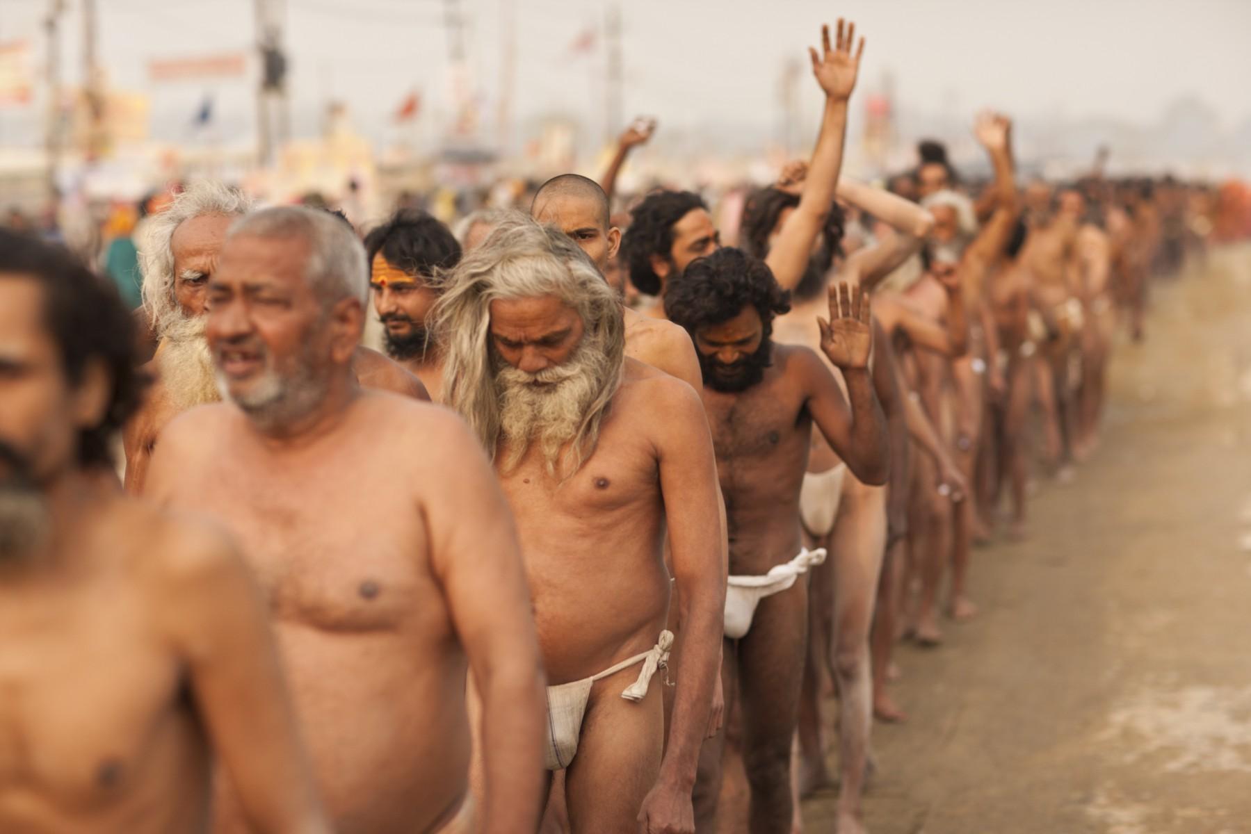 Sadhus walk to their initiation ceremony