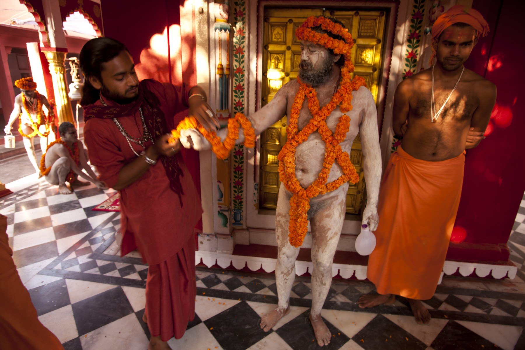 Sadhus decorated with garlands