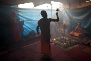 Akshay Giri begins Aarti in the early morning inside their tented encampment: Kumbh Mela, Prayag