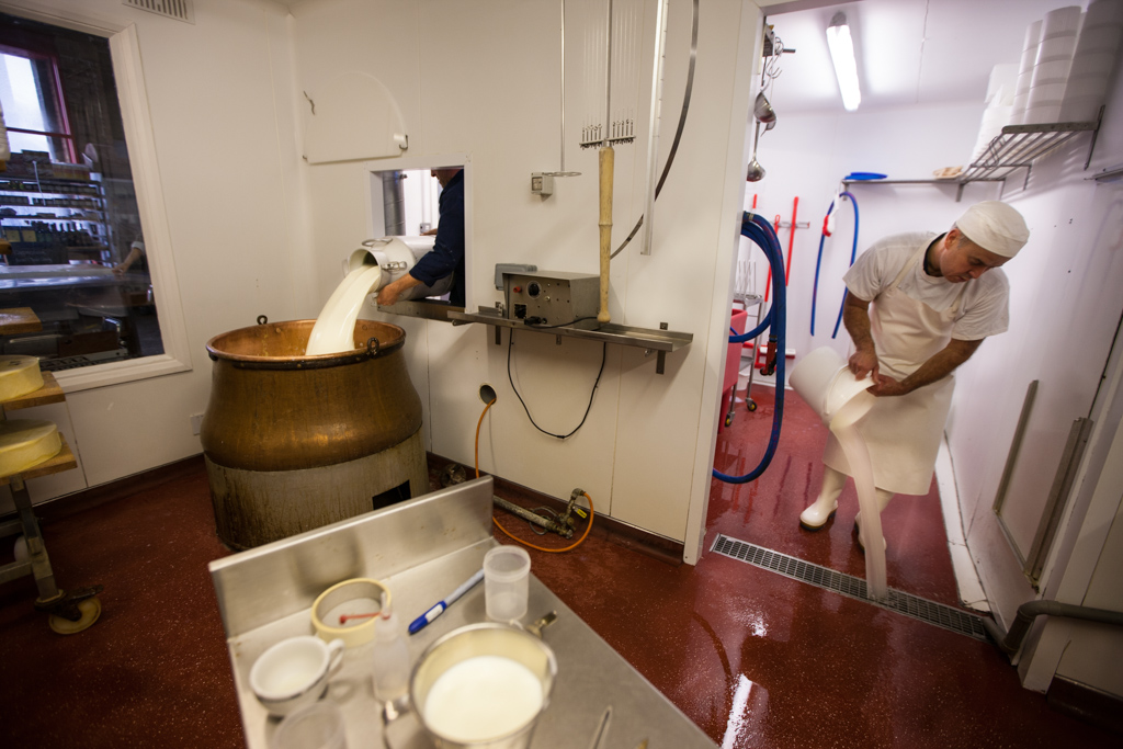 The milk is poured into a traditional 100 year old copper vat from Switzerland