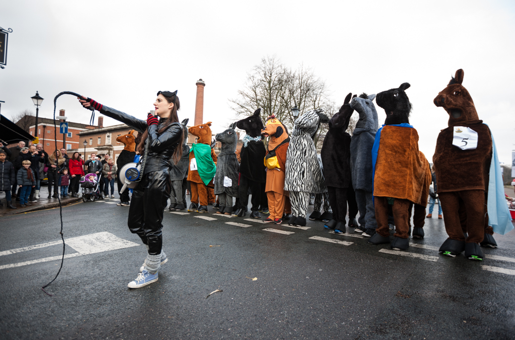 At the start of the third leg of the charity fund raising event The London Pantomime Horse Race outside the Greenwich Tavern